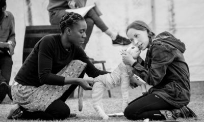 Katy Owen as Lily Tregenza, Tips the Cat and puppeteer Nandi Bhebhe Credit Steve Tanner